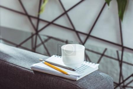 notebook, pencils and coffee