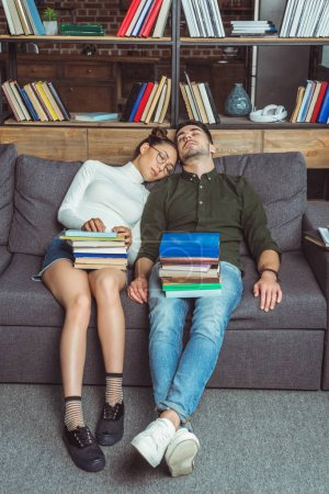 sleeping couple with books