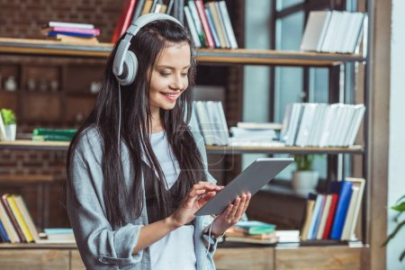 girl in headphones with digital tablet