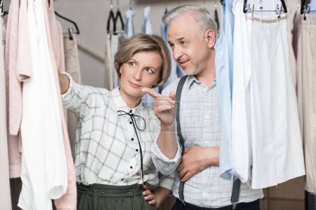 man showing what clothes to choose