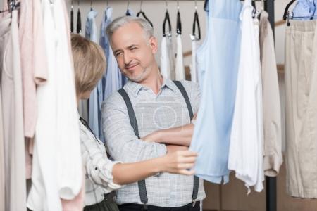 Woman showing shirt to husband