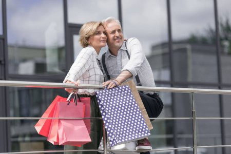 Wife and husband hugging and looking up