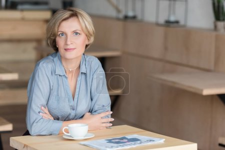 Woman posing at coffee table