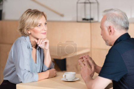 Photo for Man and woman talking during lunch time with coffee - Royalty Free Image