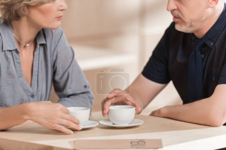 Woman and man drinking coffee