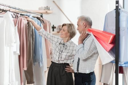 Woman showing shirt to man