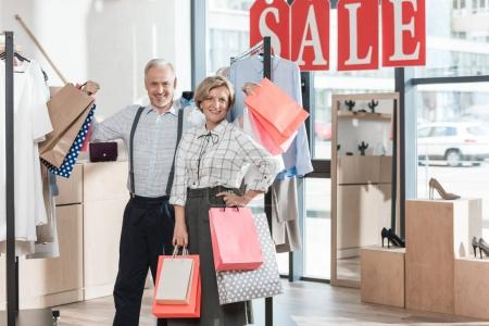 couple standing with shopping bags