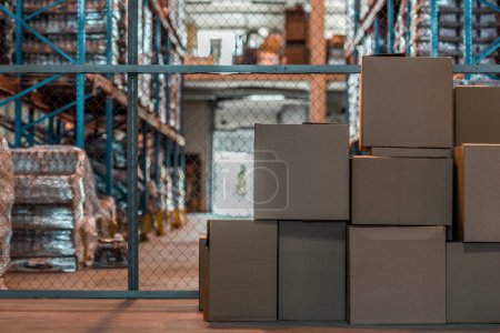 Photo for Cardboard boxes in modern storehouse interior - Royalty Free Image