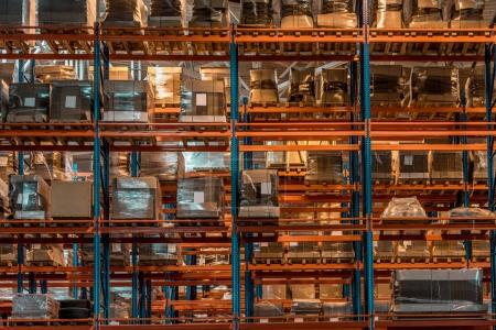 Photo for Boxes and containers on shelves in modern warehouse - Royalty Free Image