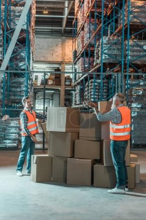 warehouse workers with boxes