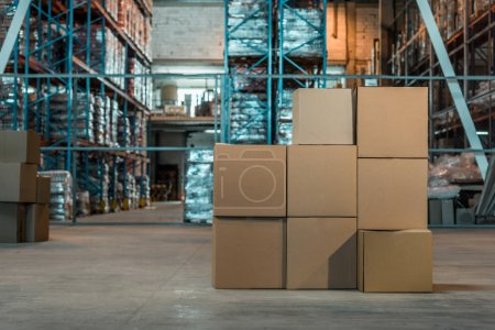 Photo for Cardboard boxes in modern warehouse interior - Royalty Free Image