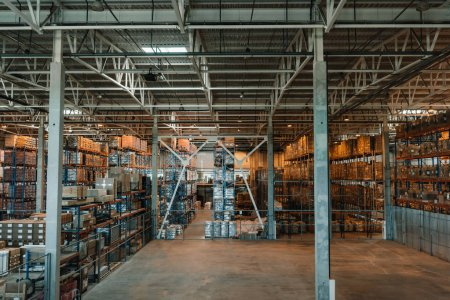 Photo for Modern storehouse interior with boxes and containers on shelves - Royalty Free Image