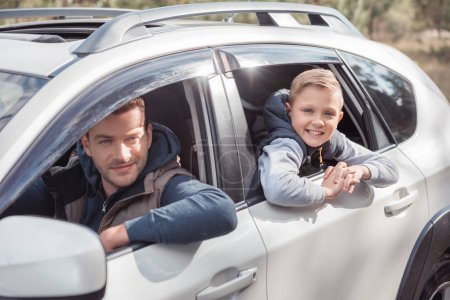 father and son in car