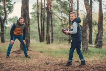 father and son playing with