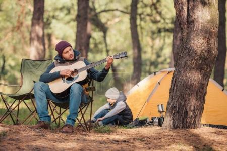 father and son with guitar