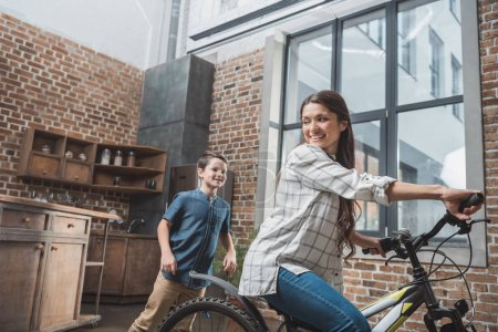Woman riding bike at home