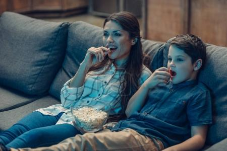 Mother and son watching movie
