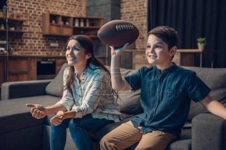 Cheering family watching american football