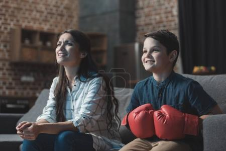 Family watching boxing match