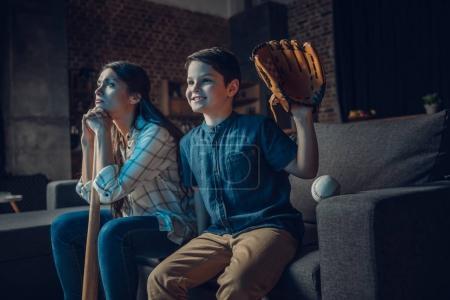 family watching baseball at home