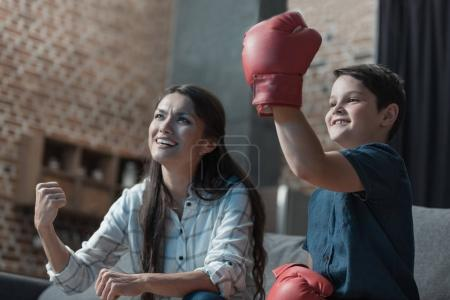 Cheering family watching boxing match