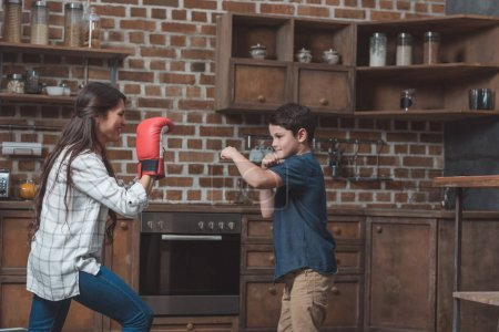 boy practicing boxing punches