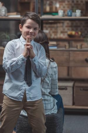 Boy posing with fingergun
