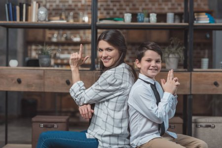 Mother and son posing with fingerguns