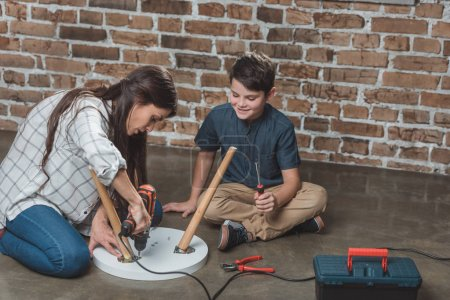 Mother and son assembling table