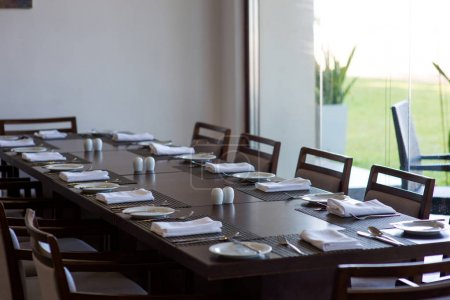 Served table in empty restaurant