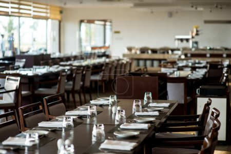Photo for Empty restaurant with served tables for catering - Royalty Free Image