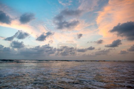 Photo for Cloudy sunset sky over beautiful calm sea - Royalty Free Image
