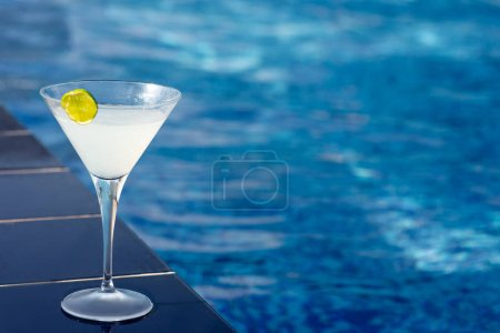 Photo for Margarita cocktail standing by swimming pool - Royalty Free Image