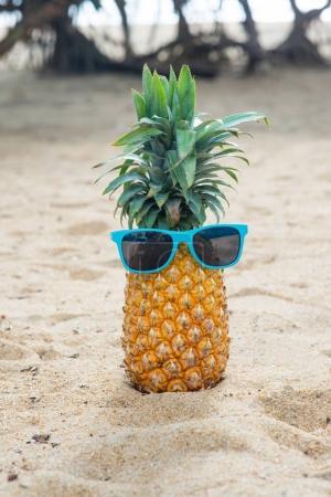 pineapple in blue sunglassses