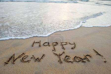 happy new year sign on beach