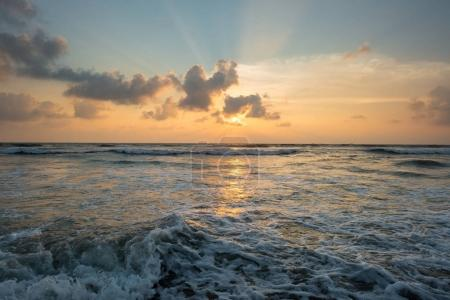 Photo for Beautiful sunset over wavy sea at sri lanka - Royalty Free Image