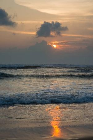 Photo for Tranquil sunset over wavy sea - Royalty Free Image