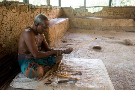 Photo for SRI LANKA - OCTOBER 26, 2017: mature indian man carving wooden stick - Royalty Free Image