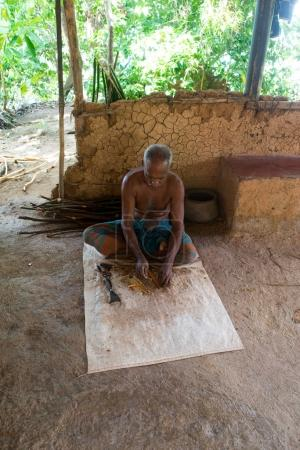 indian man carving wooden stick