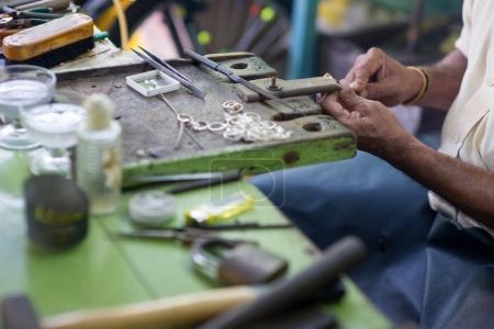 Photo for Cropped shot of oriental jewelry master making rings at sri lanka manufacture - Royalty Free Image