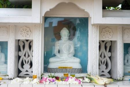 buddha statue behind glass