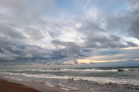 Photo for Beautiful cloudy sky over stormy waving sea at evening - Royalty Free Image