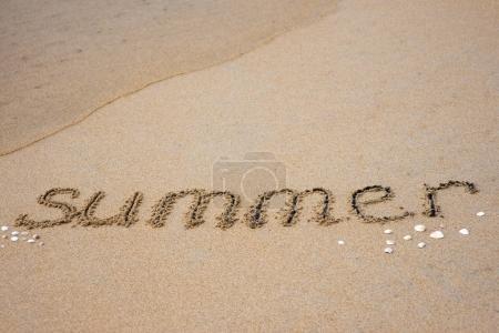 Summer inscription on sand