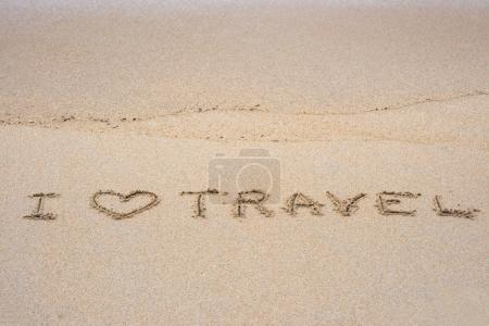 i love travel sign on sand