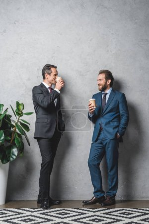 Businessmen with coffee to go