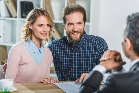 couple discussing contract with lawyer