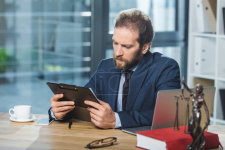 lawyer with contract at workplace