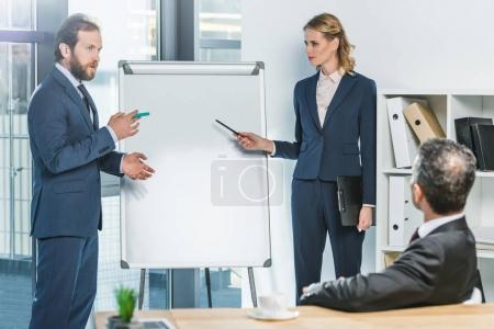 lawyers pointing at white board