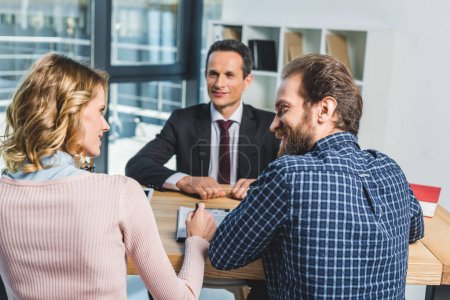 Photo for Selective focus of couple looking at each other during meeting with lawyer in office - Royalty Free Image