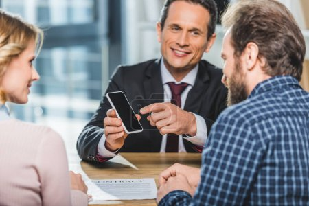 lawyer pointing at smartphone